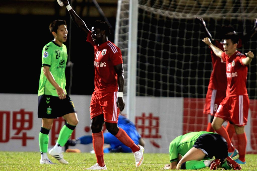 Players of Vietnam Becamex Binh Duong celebrate scoring during the group stage of 2015 AFC Champions League against South Korea's Jeonbuk Hyundai Motors in ...