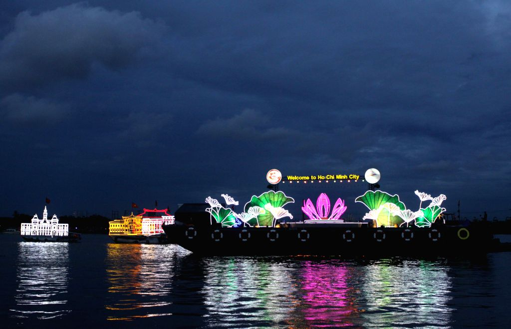 A cruise boat performs on Saigon river during the Lighting River Cruises Festival in Ho Chi Minh City, Vietnam, on Sept. 9, 2014.