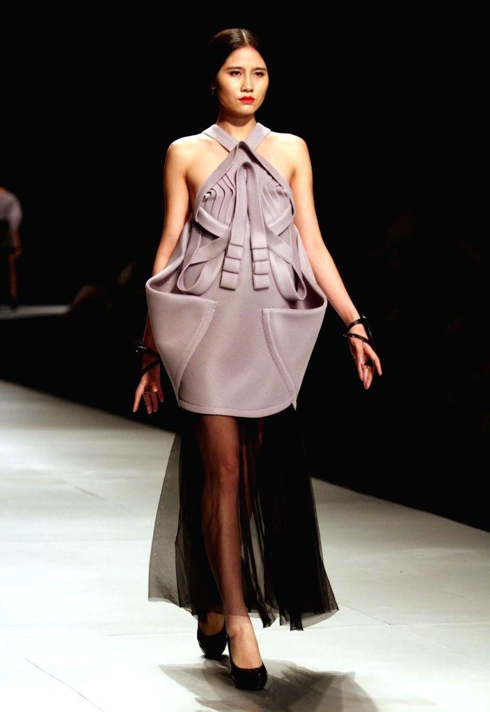 Ho Chi Minh city (Vietnam): A model presents a creation of Vietnamese designer Ly Giam Tien during the Vietnam International Fashion Week 2014 in Ho Chi Minh city, Vietnam, Dec. 5, 2014. ...