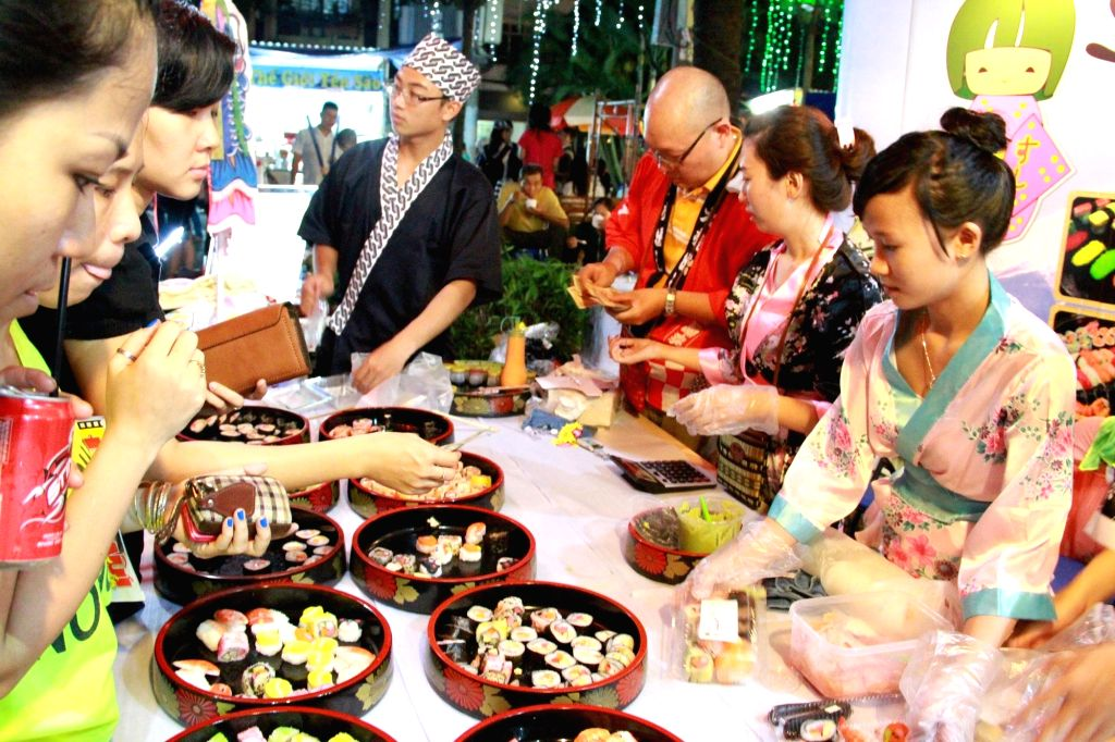 Ho Chi Minh city (Vietnam): Local people attend the 9th Taste of the World 2014 culinary festival in Ho Chi Minh City, Vietnam, Dec. 4, 2014.