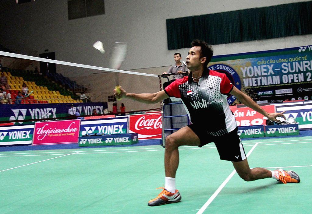 Dionysius Hayom Rumbaka of Indonesia returns a shot to India's Prannoy H. S during the men's singles final match of Yonex Sunrise - Vietnam GP Open 2014 ...