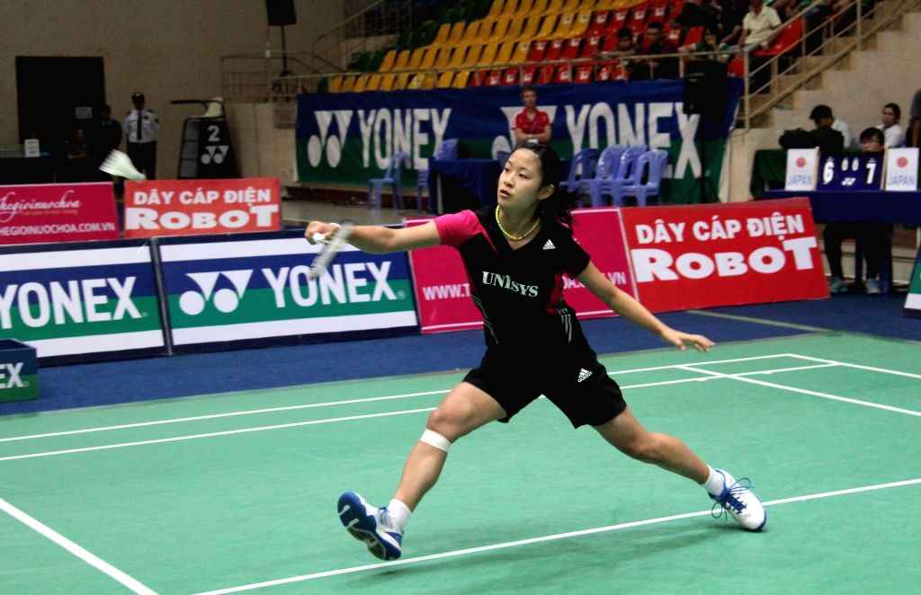 Japan's Nozomi Okuhara returns a shot to her compatriot Aya Ohori during the women's singles final match of Yonex Sunrise - Vietnam GP Open 2014 badminton ...