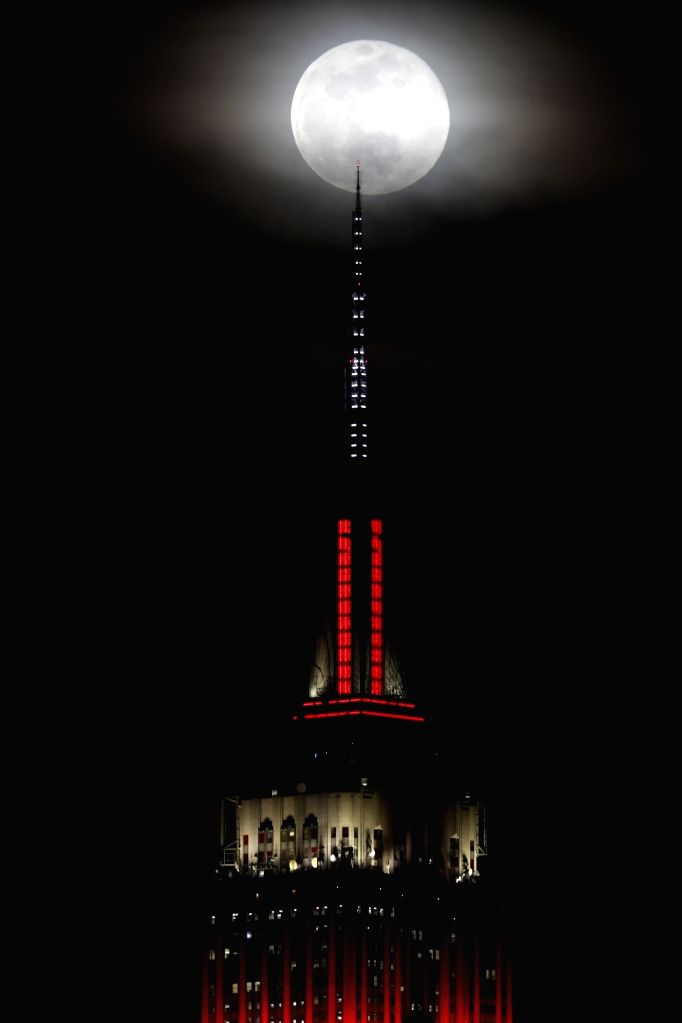 HOBOKEN (U.S.), Feb. 20, 2019 Photo taken from Hoboken of New Jersey shows a full moon over the Empire State Building in New York, the United States, on Feb. 19, 2019.
