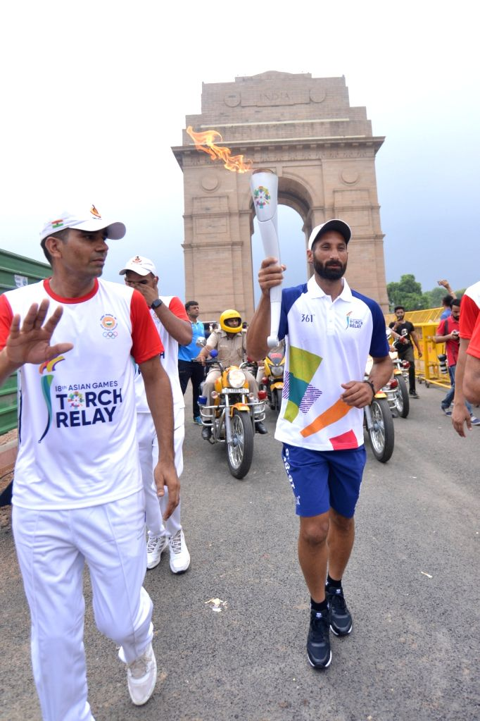 Hockey player Sardara Singh holds the torch of the 18th Asian Games Jakarta-Palembang 2018 as the torch relay commenced from Major Dhyanchand National Stadium, in New Delhi on July 15, ... - Sardara Singh