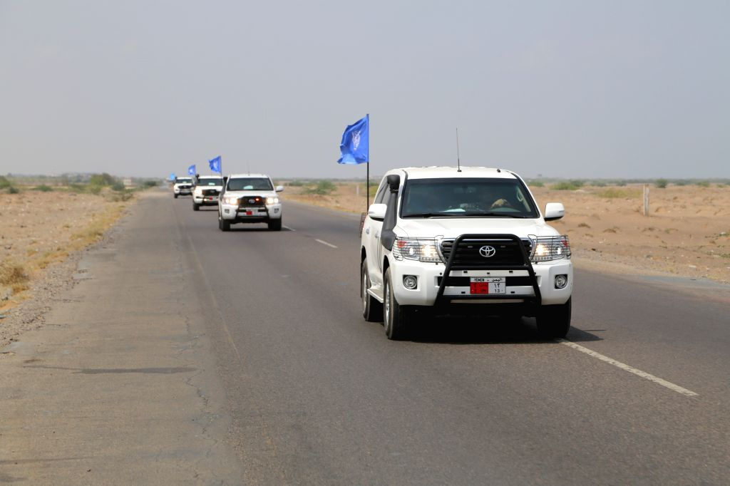 HODEIDAH (YEMEN), May 11, 2019 UN vehicles are seen on their way to Salif port in Hodeidah, Yemen, on May 11, 2019. Yemen's Houthi rebels began on Saturday withdrawal from two ports of ...