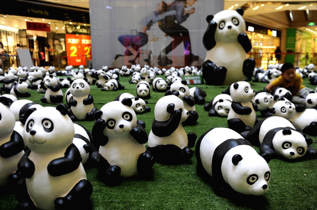 Panda figures are displayed at a shopping mall in Hohhot, capital of Inner Mongolia Autonomous Region, Aug. 26, 2014. About 100 panda figures were shown in the ...