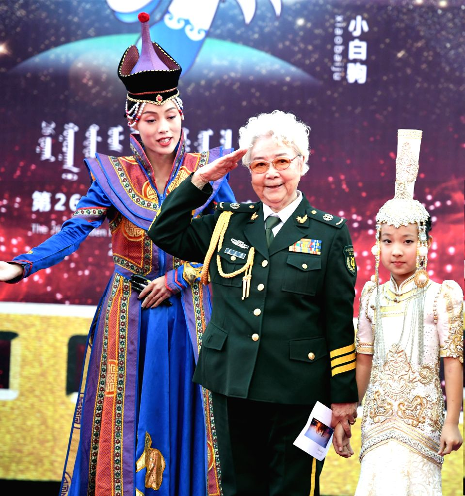 HOHHOT, Sept. 16, 2017 - Actress Tian Hua (C) salutes on the red carpet before the Awarding Ceremony of the 26th China Golden Rooster & Hundred Flowers Film Festival in Hohhot, north China's ... - Tian Hua