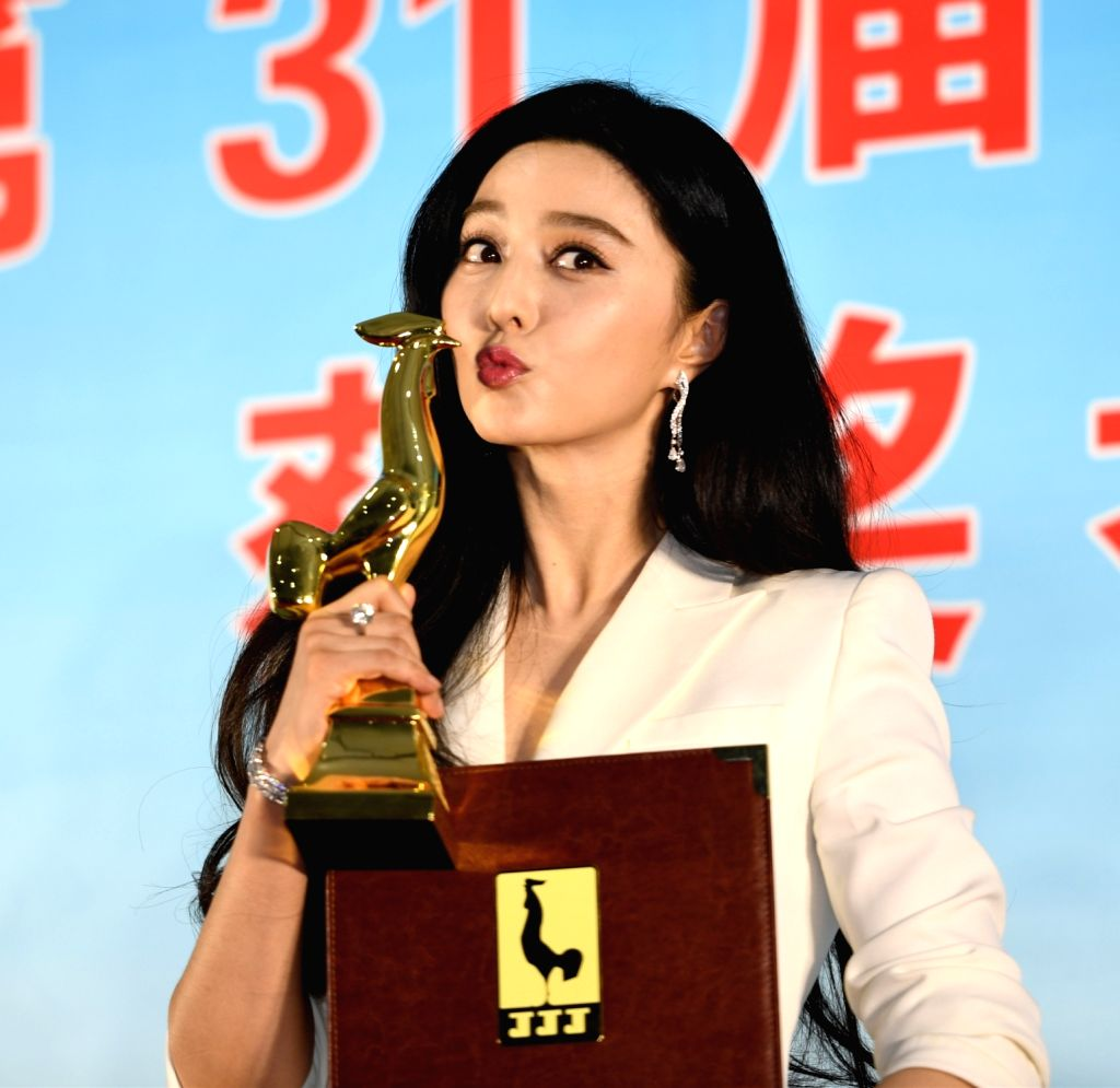 """HOHHOT, Sept. 17, 2017 - Fan Bingbing shows the trophy of the Best Actress for the film """"I Am Not Madame Bovary"""" at the awarding ceremony of the 31st Golden Rooster Awards in Hohhot, ..."""