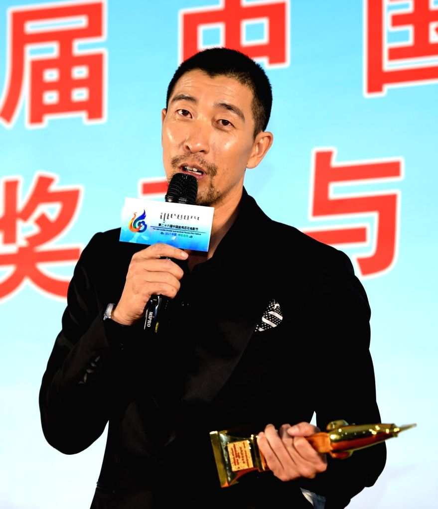 """HOHHOT, Sept. 17, 2017 - Wang Qianyuan shows the trophy of the Best Supporting Actor for the film """"Saving Mr. Wu"""" at the awarding ceremony of the 31st Golden Rooster Awards in Hohhot, ..."""