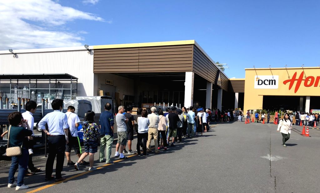HOKKAIDO, Sept. 6, 2018 (Xinhua) -- People queue in front of a supermarket after an earthquake in Date, Hokkaido, Japan, on Sept. 6, 2018. A 6.9-magnitude earthquake hit Japan's Hokkaido prefecture on Thursday. (Xinhua/Deng Min/IANS)