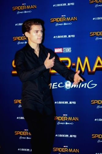 """Hollywood actor Tom Holland, who stars in the new movie """"Spider-Man: Homecoming,"""" poses for a photo during a publicity event in Seoul on July 3, 2017. The movie will be released in ... - Tom Holland"""