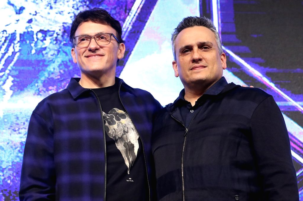 """Hollywood directors Anthony Russo (L) and Joe Russo pose for a photo during a press conference in Seoul on April 15, 2019, to promote the new movie """"Avengers: Endgame."""" The movie ..."""