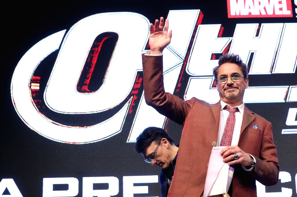 """Hollywood star Robert Downey, Jr. poses for a photo during a press conference in Seoul on April 15, 2019, to promote the new movie """"Avengers: Endgame."""" The movie will be released in ..."""