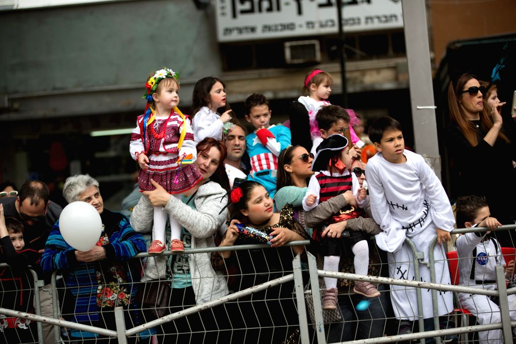 HOLON(ISRAEL), March 12, 2017 People watch the Holon Purim Parade in Holon, central Israel on March 12, 2017. Purim is a Jewish holiday that commemorates the deliverance of the Jewish ...