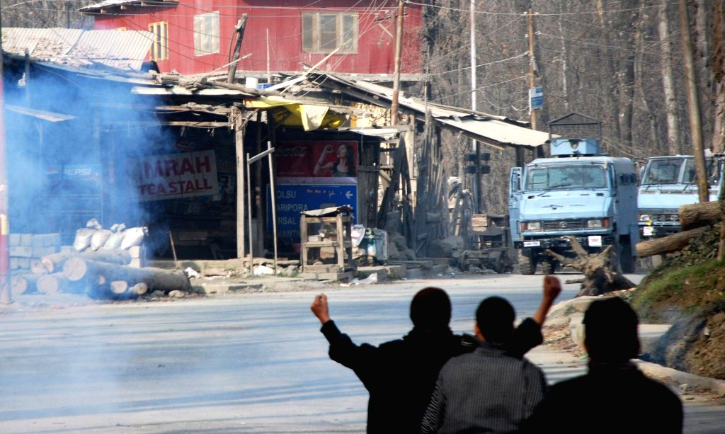 Hom Shalibugh: Youths clash with security forces at Koimoo village under Hom Shalibugh assembly during the second phase of Jammu and Kashmir assembly polls in Kulgam district on Dec 2, 2014.
