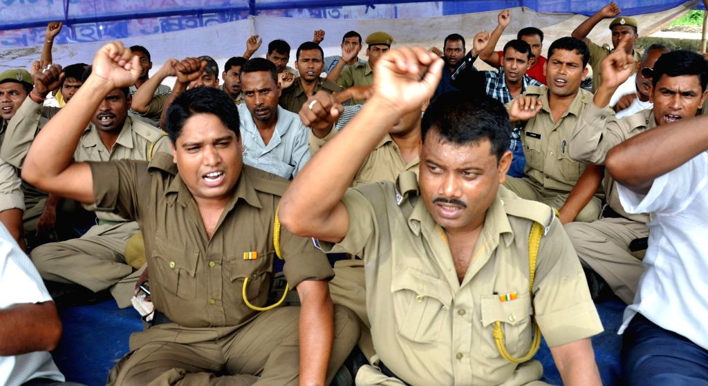 Home Guards stage a demonstration to press for their demands in Guwahati on Aug 22, 2014.