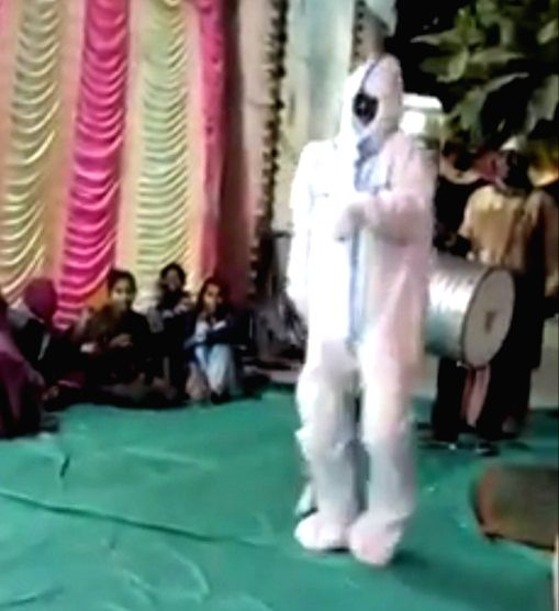Home quarantined man dances in PPE kit at marriage ceremony.