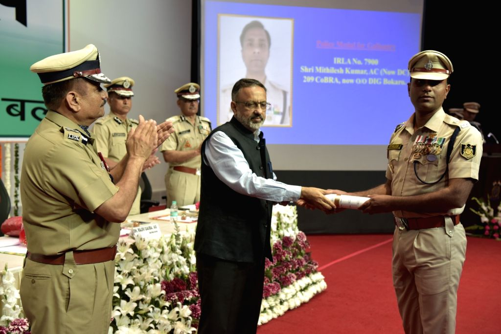 Home Secretary Rajiv Gauba felicitates a CRPF personnel during a programme organised on the annual 'Valour Day' of the CRPF, in New Delhi on April 9, 2019.
