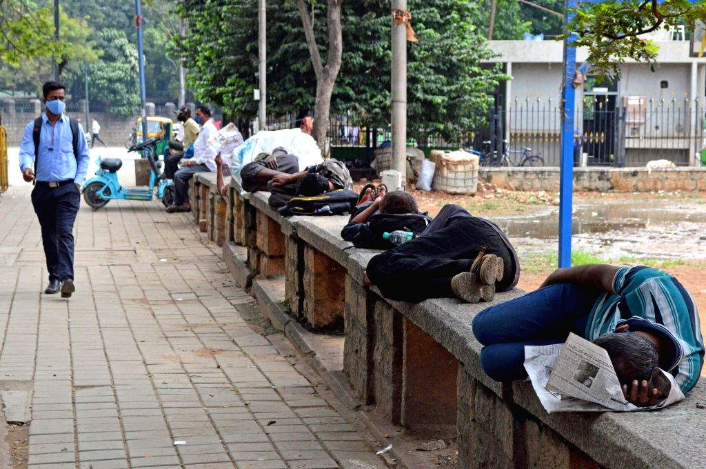 Homeless people napping on the stone benches at Bannappa Park, in Bengaluru on Oct 20, 2020.