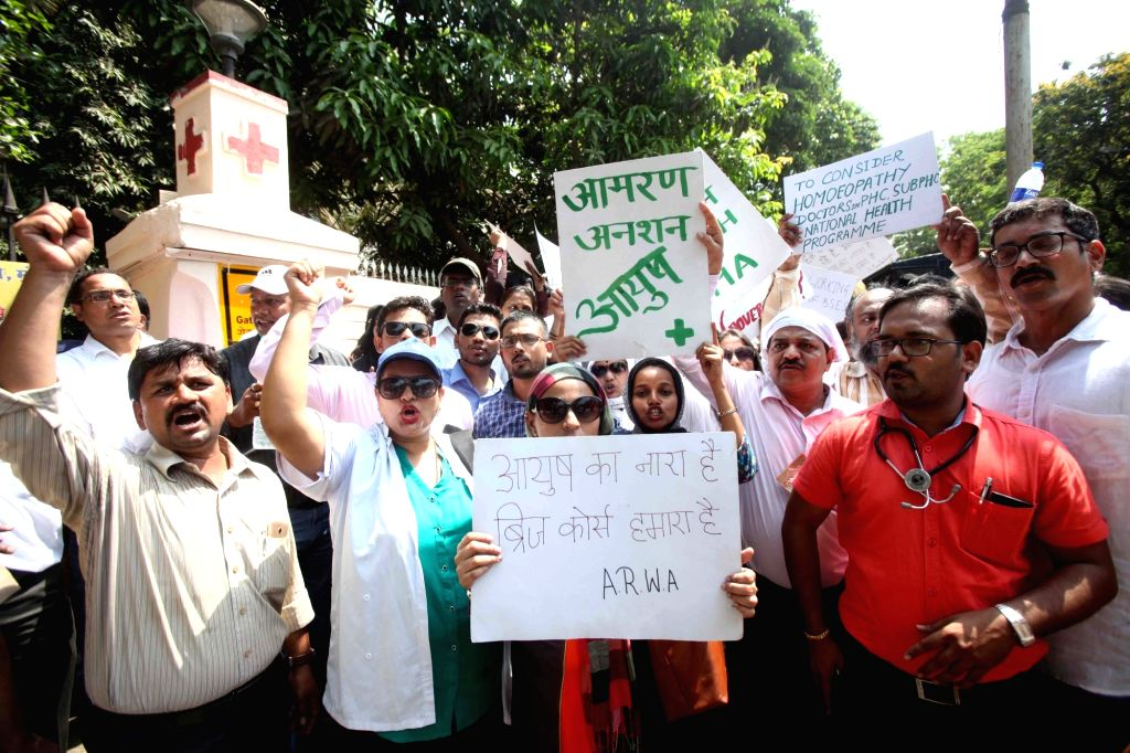 Homeopathy practitioners stage an indefinite hunger strike against the National Medical Council bill's amendment to scrap bridging course for AYUSH doctors to practice allopathy, in Mumbai on ...