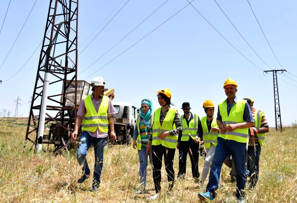 HOMS, June 5, 2019 - Electrical workers are seen after fixing a high-voltage electricity line in Homs province, central Syria on May 30, 2019. As the war in Syria rumbled on, Syrian women started to ...