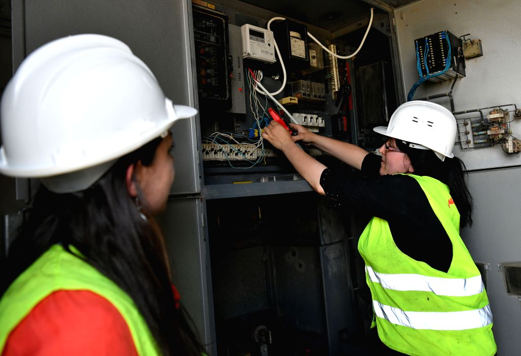 HOMS, June 5, 2019 - Female electrical workers fix electrical transformers in Homs province, central Syria on May 30, 2019. As the war in Syria rumbled on, Syrian women started to engage in more jobs ...
