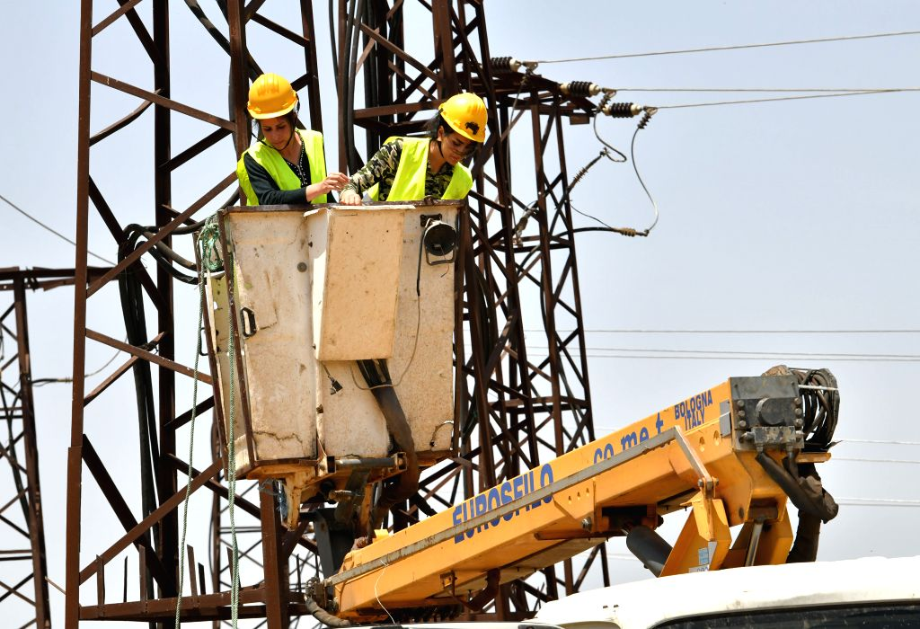 HOMS, June 5, 2019 - Female electrical workers fix a high-voltage electricity line in Homs province, central Syria on May 30, 2019. As the war in Syria rumbled on, Syrian women started to engage in ...