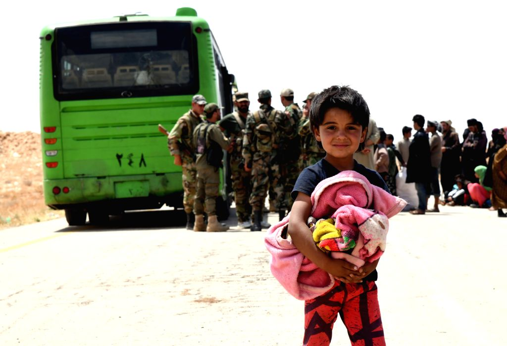 HOMS (SYRIA), June 12, 2019 A displaced Syrian kid arrives at the Jlaighem crossing in the eastern countryside of Homs Province in central Syria, on June 12, 2019. A new batch of ...