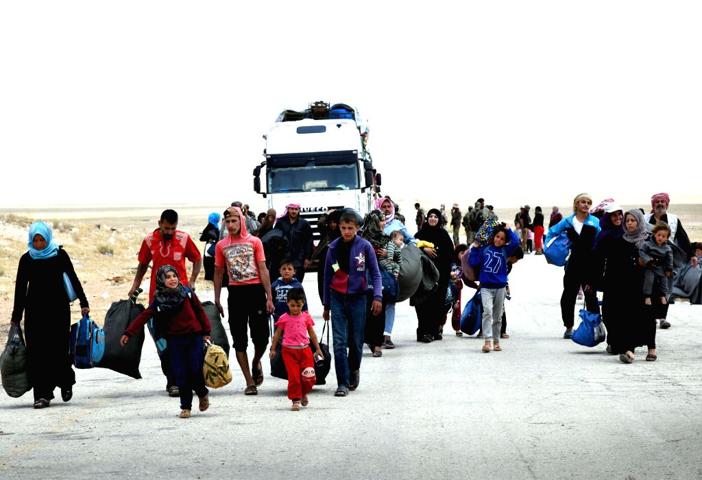 HOMS (SYRIA), June 12, 2019 Displaced Syrians arrive at the Jlaighem crossing in the eastern countryside of Homs Province in central Syria, on June 12, 2019. A new batch of civilians left ...