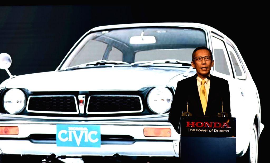 "Honda Cars India President and CEO Gaku Nakanishi addresses at the launch of 2019 Honda new ""Civic"" in New Delhi, on March 7, 2019."