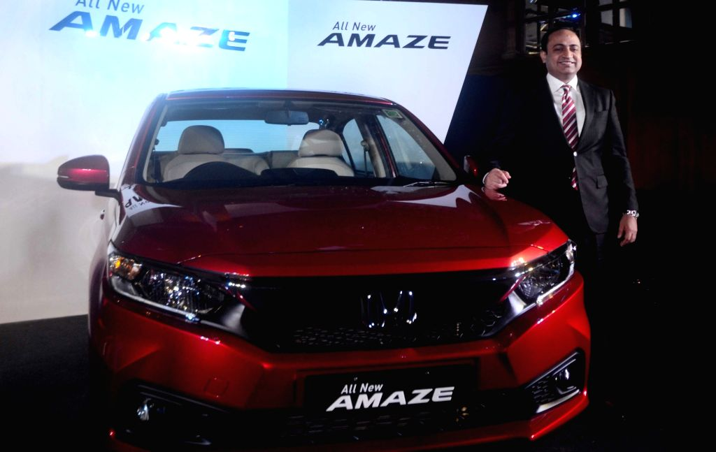 Honda Cars India Senior Vice President and Director Rajesh Goel with the newly launched Honda Amaze, in Kolkata on May 21, 2018.