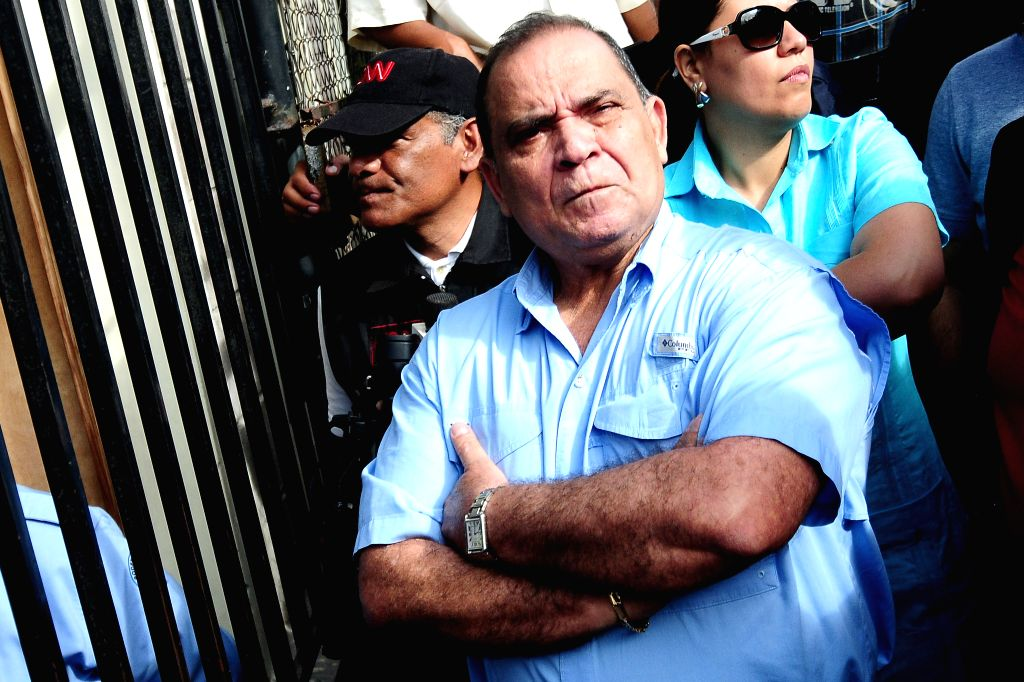 Honduran journalist David Romero reacts on his arrival at a hearing at Tegucigalpa Courts, in Tegucigalpa, Honduras, on Nov. 13, 2015. An Honduran judge found ...