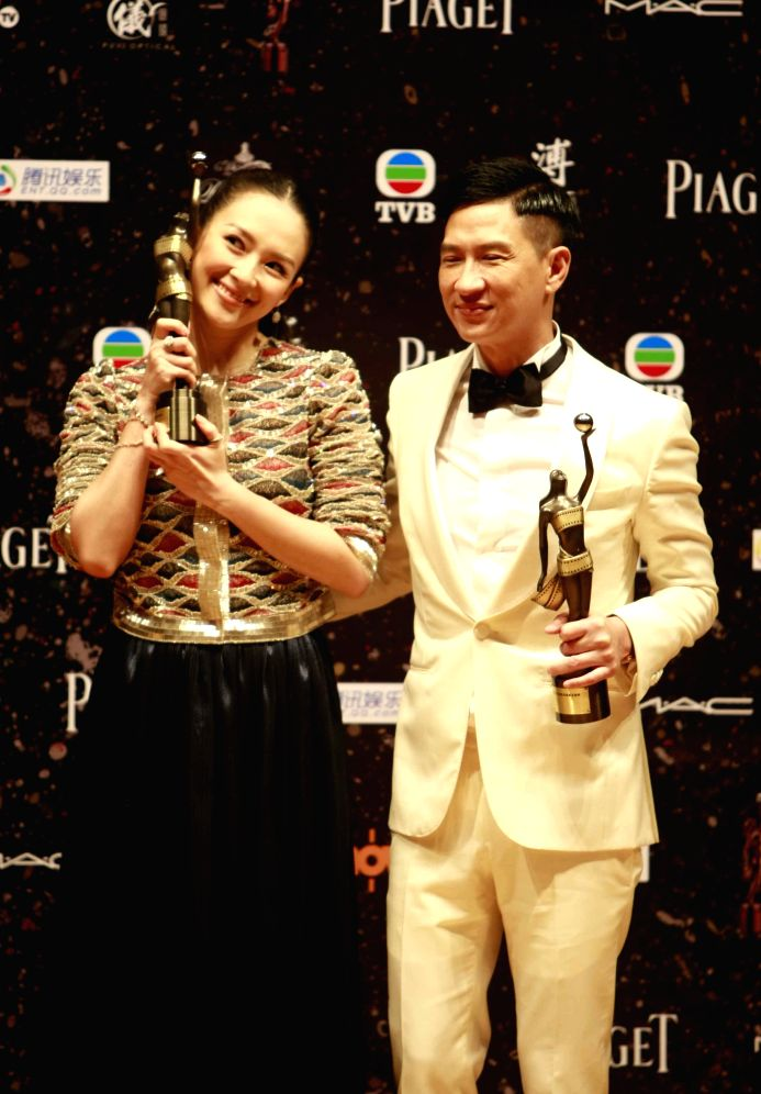 """Nick Cheung, winner of the Best Actor award for his performance in the movie """"Unbeatable"""", shows his trophy at the presentation ceremony of the 33rd ..."""