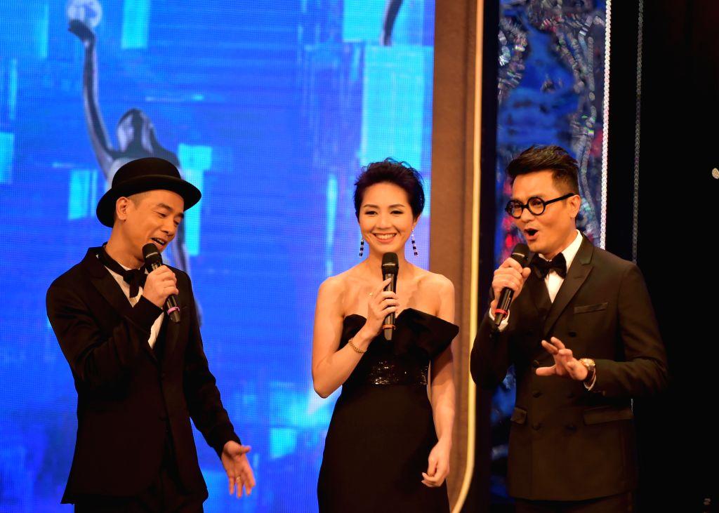Actress Miriam Yeung (C) and actor Jordan Chan (L) attend the 34th Hong Kong Film Awards presentation ceremony in south China's Hong Kong, April 19, 2015. ... - Miriam Yeung