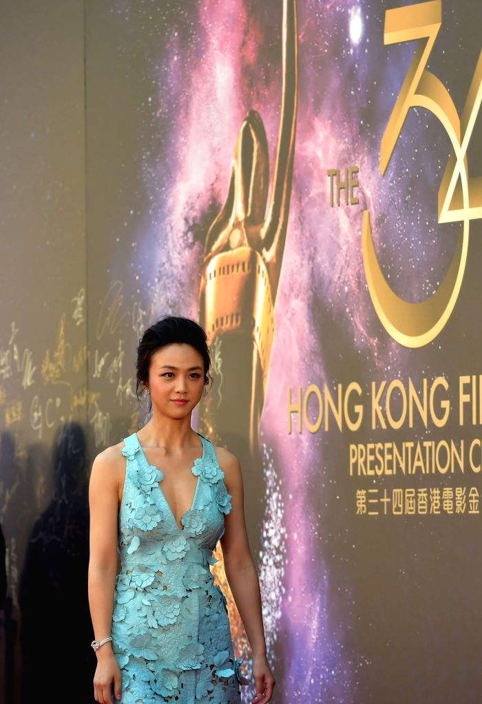 Tang Wei, nominee for the best actress, walks the red carpet before the 34th Hong Kong Film Awards presentation ceremony in Hong Kong, south China, April 19, ...