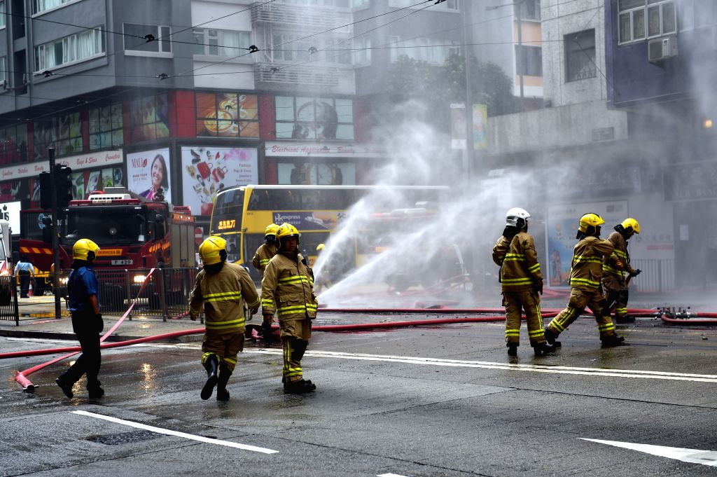 HONG KONG, April 19, 2016 - Firemen put out fire in a building at Hennessy Road in Wan Chai, south China's Hong Kong, April 19, 2016. Two old people were hospitalized after the fire accident.