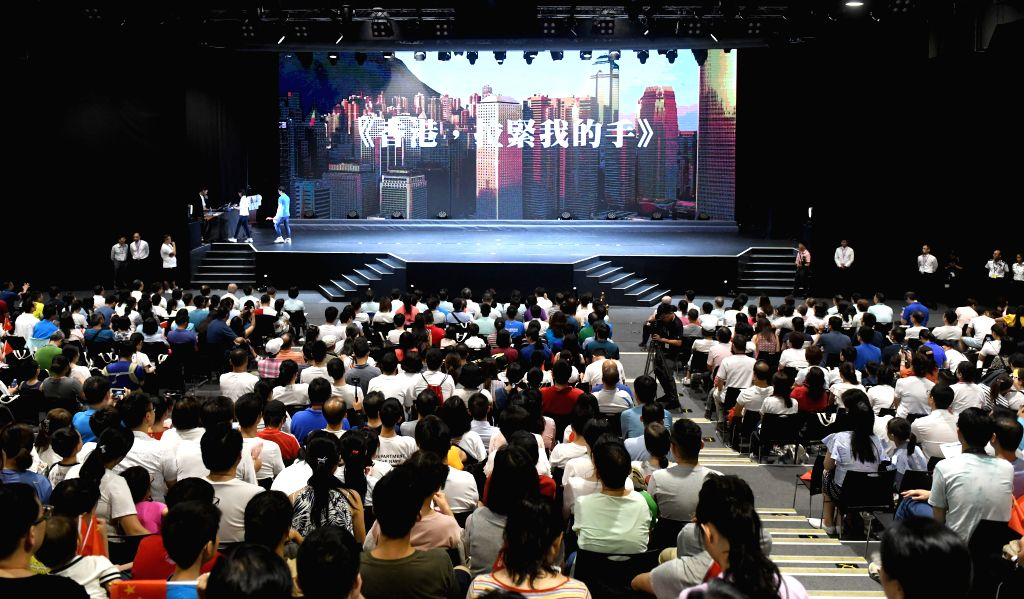 HONG KONG, Aug. 25, 2019 - People attend an event held in the Ocean Park organized by Hong Kong Chinese Enterprises Association to unite families in their calls for order and harmony in south China's ...