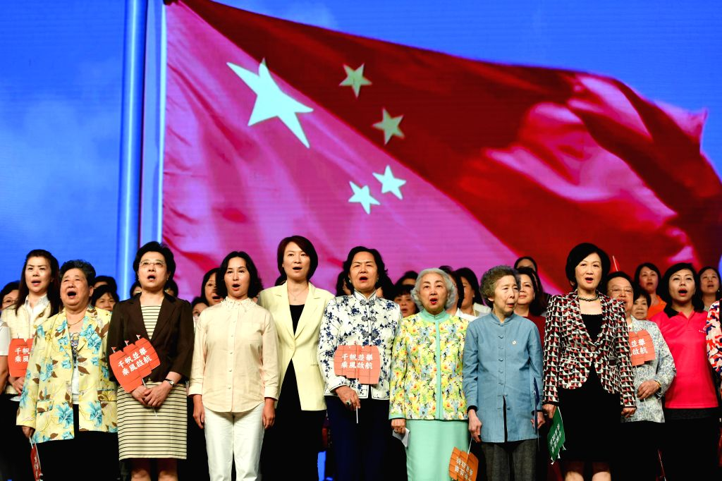 HONG KONG, Aug. 26, 2019 - Participants chorus the Chinese national anthem during the All Hong Kong Women Gathering in south China's Hong Kong, Aug. 25, 2019.