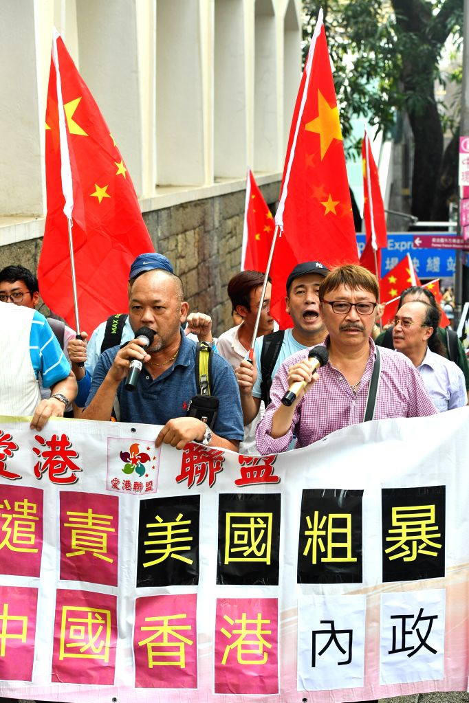 HONG KONG, Aug. 27, 2019 - Protesters march to the U.S. Consulate General in China's Hong Kong Special Administrative Region (HKSAR) during a demonstration against the U.S. interference in China's ...