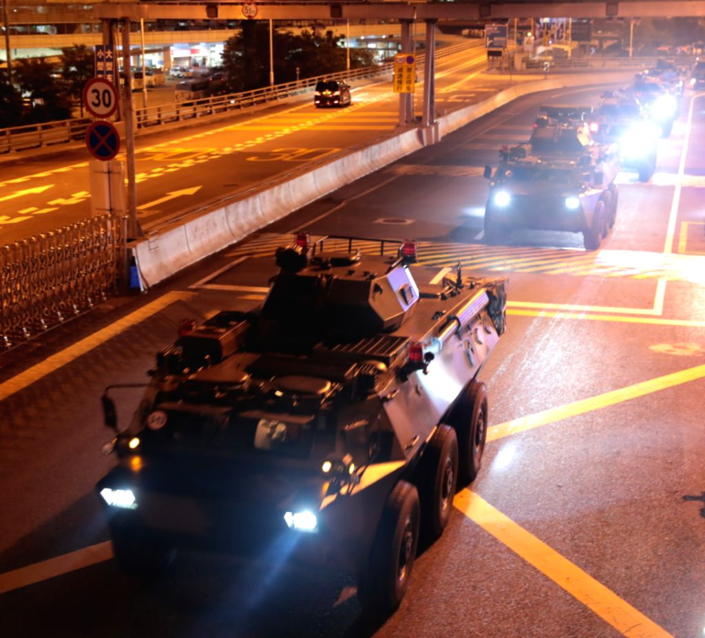 HONG KONG, Aug. 29, 2019 - Military vehicles of the Chinese People's Liberation Army (PLA) pass Huanggang Port for a routine troop rotation in south China's Hong Kong, Aug. 29, 2019. The Hong Kong ...