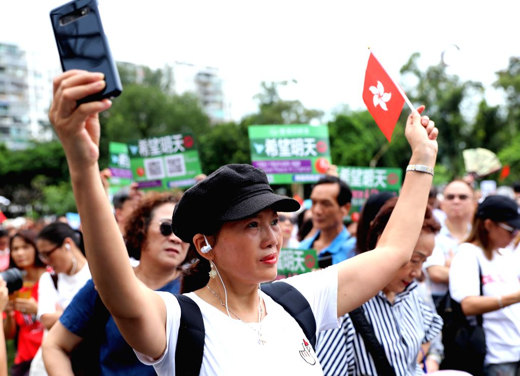HONG KONG, Aug. 3, 2019 - People take part in a rally to denounce violence and support police force at Victoria Park in Hong Kong, south China, Aug. 3, 2019. Tens of thousands of Hong Kong residents ...