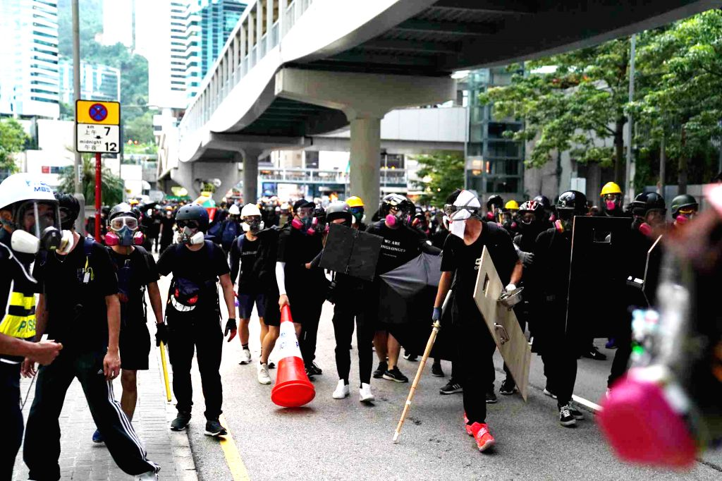 HONG KONG, Aug. 31, 2019 (Xinhua) -- Rioters launch an attack on the police in south China's Hong Kong, Aug. 31, 2019. A large group of rioters vandalized and threw petrol bombs into the headquarters of the Hong Kong Special Administrative Region (HK
