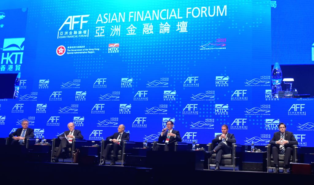 Chan Tak-Lam(3rd R), chief executive of Hong Kong Monetary Authority (HKMA) speaks during the 2015 Asian Financial Forum in Hong Kong, south China, Jan. 19, 2015.