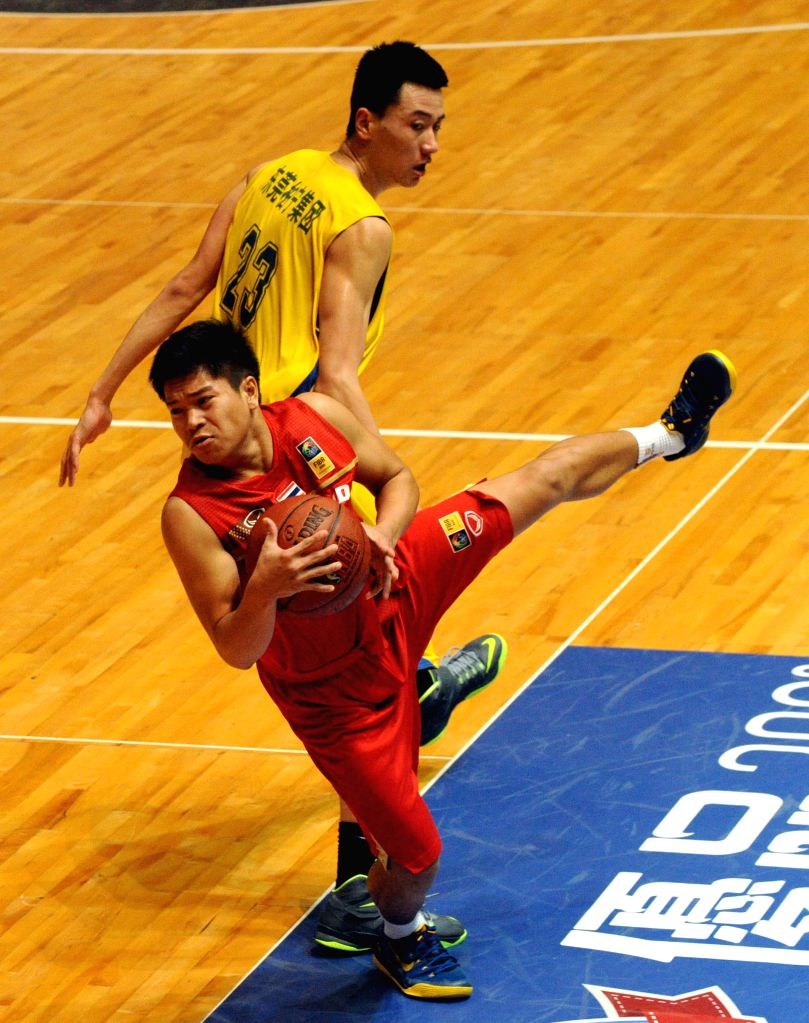 Suchon Maitamptiak (front) of Thailand vies with Li Xiaopeng of Hunan Baining during the Super Kung Sheung Cup between Hunan Baining and Thailand in the Queen ...