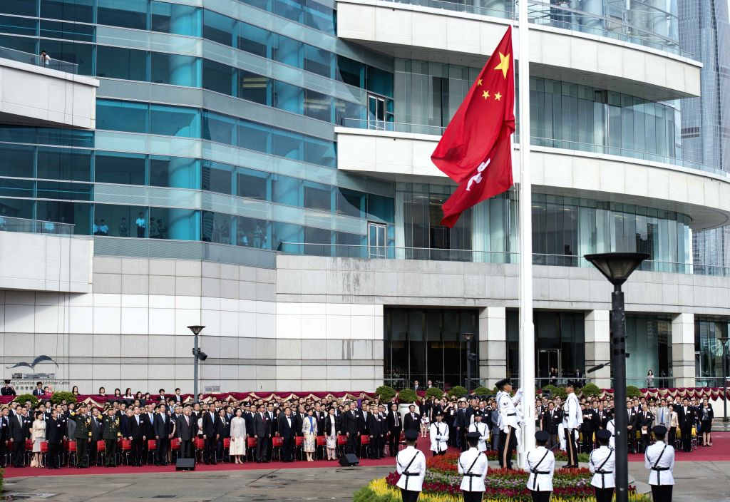 HONG KONG, July 1, 2016 - A flag raising ceremony is held at the Golden Bauhinia Square in Hong Kong, south China, July 1, 2016, to celebrate the 19th anniversary of the establishment of Hong Kong ...