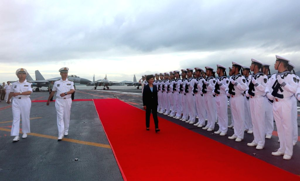 HONG KONG, July 7, 2017 - Chief Executive of Hong Kong Special Administrative Region (HKSAR) Lam Cheng Yuet-ngor inspects the guards of honor on Chinese aircraft carrier Liaoning's flight deck in ...