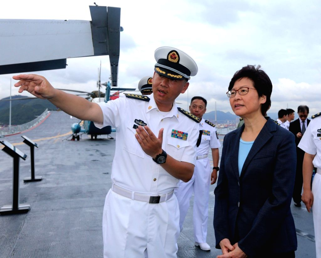 HONG KONG, July 7, 2017 - Chief Executive of Hong Kong Special Administrative Region (HKSAR) Lam Cheng Yuet-ngor listens the introduction by Liu Zhe (L), captain of Chinese aircraft carrier Liaoning, ...