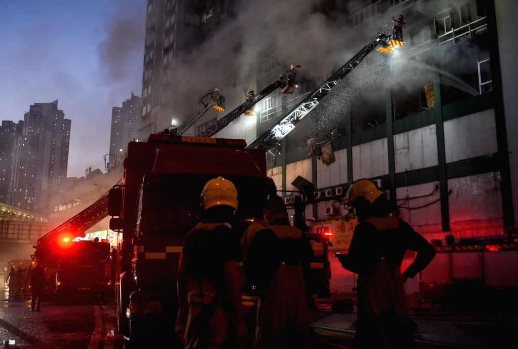 HONG KONG, Jun. 24, 2016 - Firefighters work to put out fire at a multi-storey industrial building in East Kowloon area of Hong Kong, south China, June 23, 2016. A second firefighter has died on ...