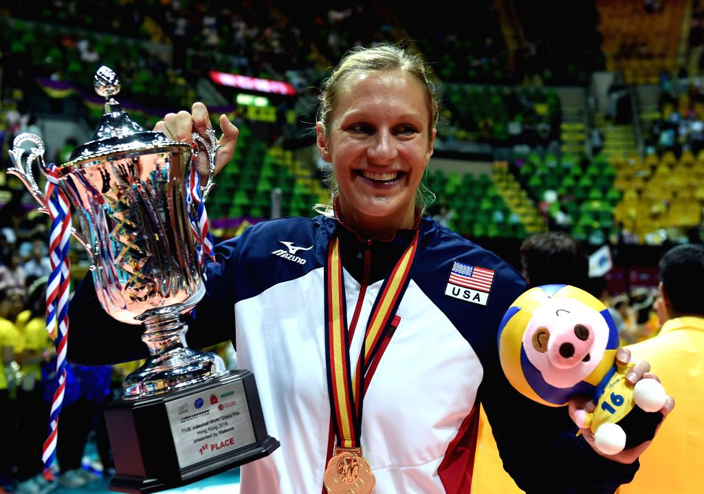 HONG KONG, June 26, 2016 - United States' Christa Harmotto Dietzen celebrates with the trophy after the awarding ceremony of FIVB volleyball World Grand Prix (Hong Kong) 2016 in Hong Kong, south ...