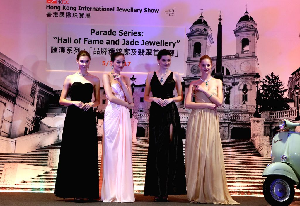 HONG KONG, March 5, 2017 - Models present jewellery at Hong Kong International Jewellery Show in Hong Kong, south China, March 5, 2017. The five-day jewellery show, with the participation of 2,580 ...